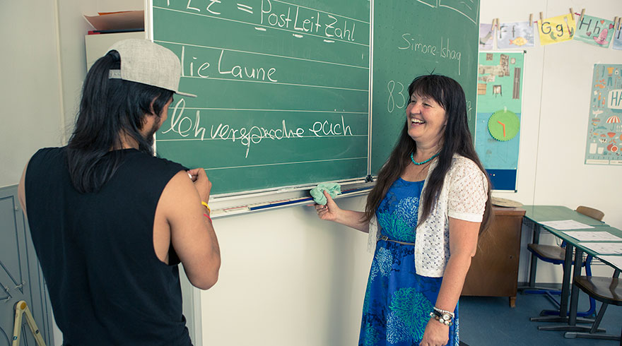 Classroom situation: Marianne Penn and a student standing at the chalkboard.